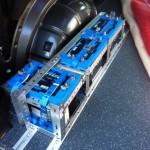 Drei Versorger-Batterien unter dem Schrank