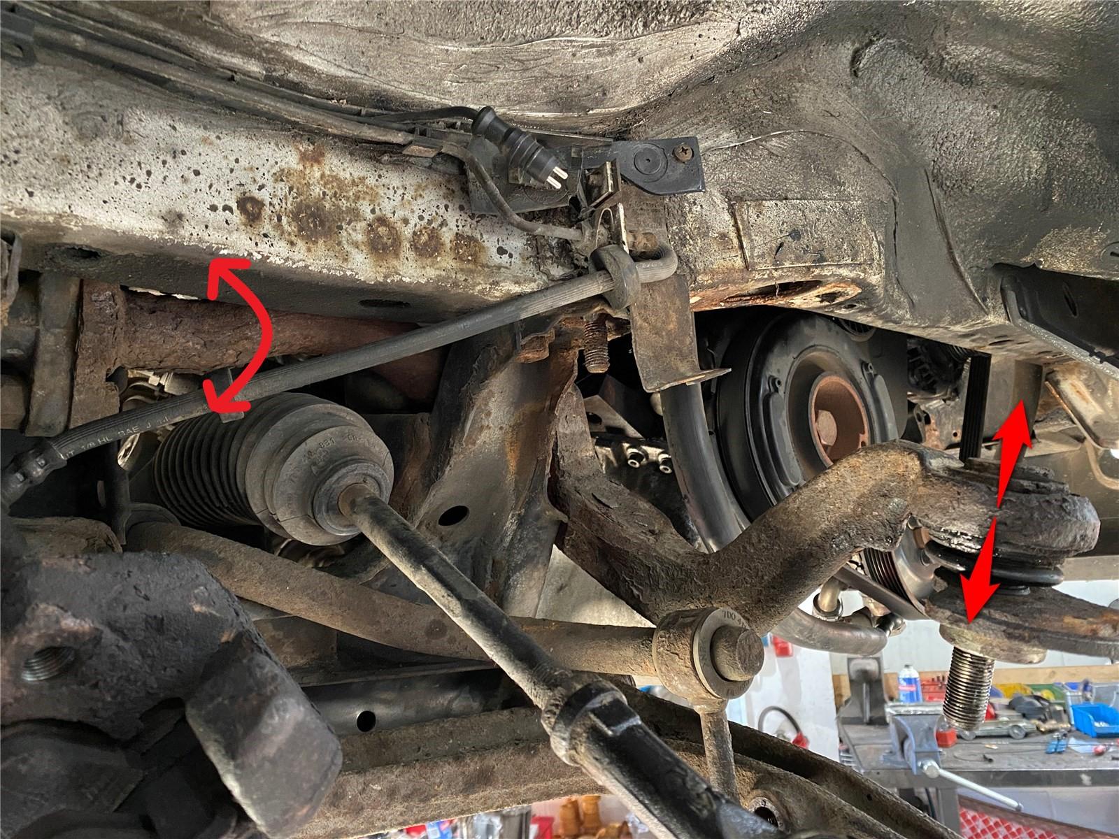 Achslenker mit Drehstab eines VW Bus T4.