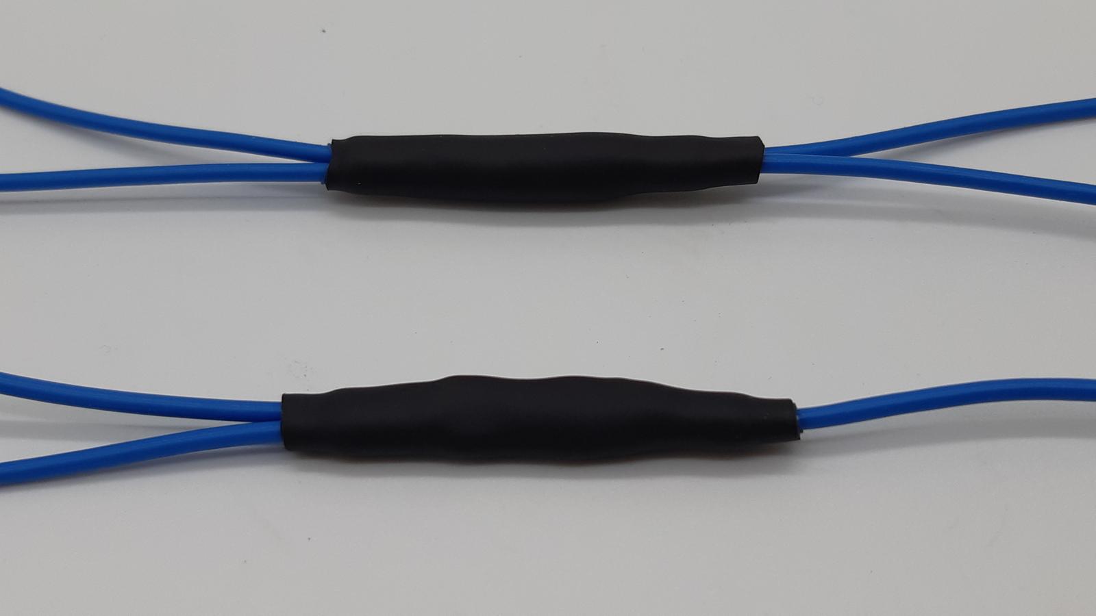 Vier- und Dreifachabzweig mit Schrumpfschlauch geschützt.